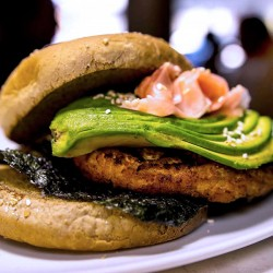 A specialty burger with avocado from Barney's.