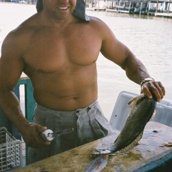 Capt. Clay Cleaning Beautiful Speckled Trout
