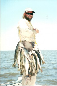 Captain Clay With A Stringer Of Speckled Trout