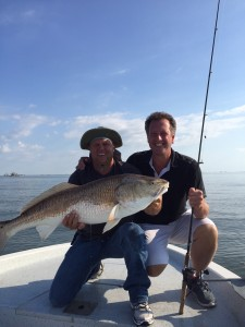 Capt. Clay With This Guys 1st Bull Red