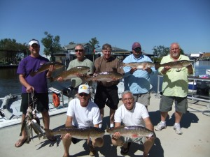 Regular customers of Bayou Log Cabins with a great day of catching red fish