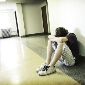 teen in hall