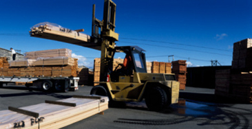 Forklift carrying lumber in lumberyard, Eureka, Humboldt County, California, USA