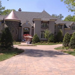 Strategic landscaping makes for a beautiful driveway for this Chicago home remodeling project by Home Services Direct.