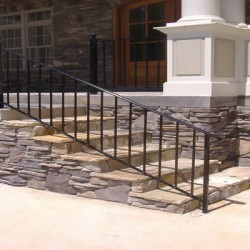 These stone steps create a statement piece for this Chicago home remodeling project by Home Services Direct.