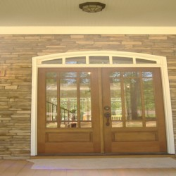 Gorgeous doors invite you into this Chicago house remodeling project by Home Services Direct.