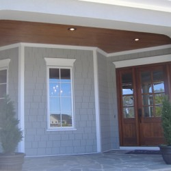 Gorgeous wood adorns the front door and porch ceiling on this Chicago home renovation project by Home Services Direct.