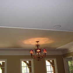 Purposeful ceiling design creates a home for this gorgeous light fixture in this house remodeling project by Home Services Direct.
