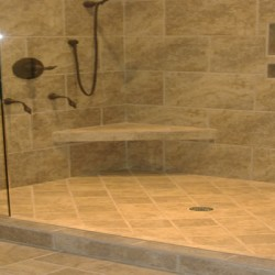 Built in ledges bring storage to this shower in this Chicago bathroom remodel by Home Services Direct.