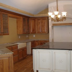 A purposeful paint job brings depth to this Chicago kitchen remodel by Home Services Direct.