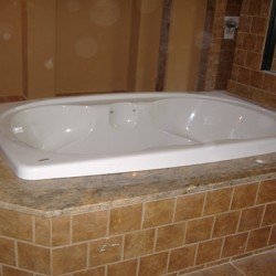 A large tub brings luxury to this Chicago bathroom remodeling project by Home Services Direct.