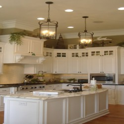 Crown molding and recessed lighting complete the look of this Chicago kitchen remodel by Home Services Direct.