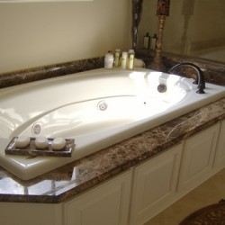 Contrasting colors create a gorgeous bathtub space in this Chicago bathroom remodel by Home Services Direct.