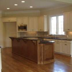 Gorgeous hardwood completes this Chicago kitchen remodel by Home Services Direct.