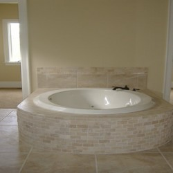 This round tub brings a unique touch to this Chicago bathroom remodel by Home Services Direct.