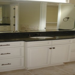 Black and white contrast to create a sleek, modern bathroom remodel by Home Services Direct.