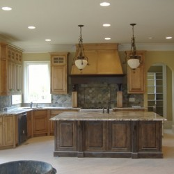 A variety of wood colors add drama to this Chicago kitchen remodel by Home Services Direct.