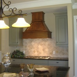 A variety of colors add character to this Chicago kitchen remodel by Home Services Direct.