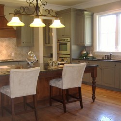 A streamlined design opens up this Chicago small kitchen remodel by Home Services Direct.