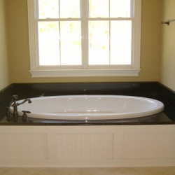 The contrast between black and white creates an inviting bathtub area in this Chicago bathroom remodeling project by Home Services Direct.