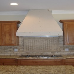 The geometric backsplash completes this Chicago kitchen remodel by Home Services Direct.