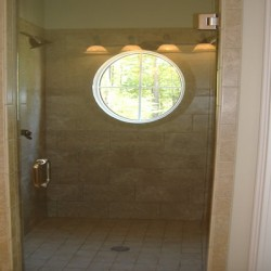 Unique windows bring natural light into this Chicago bathroom remodel by Home Services Direct.