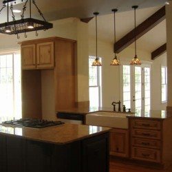 Varied lighting solutions bring character to this Chicago kitchen remodel by Home Services Direct.