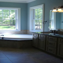 Large windows bring natural light into this gorgeous Chicago remodeling project by Home Services Direct.