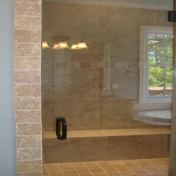 A built in bench brings shower functionality to this Chicago home remodeling project by Home Services Direct.
