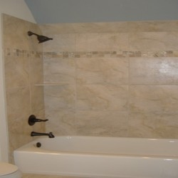 A clean, modern look completes this bathroom remodel by Home Services Direct.