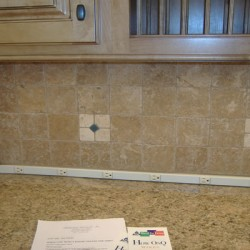 Power outlets abound in this Chicago kitchen remodel by Home Services Direct.