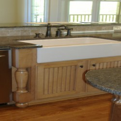 The apron front sink and wood details complete this Chicago kitchen remodel by Home Services Direct.