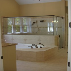 A massive shower and tub dominate this Chicago bathroom remodeling project by Home Services Direct.