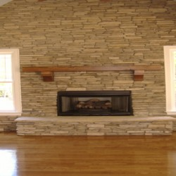 This stone wall bring character to this Chicago home remodeling project by Home Services Direct.