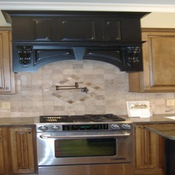 Dramatic details draw the eye in this Chicago kitchen remodel by Home Services Direct.
