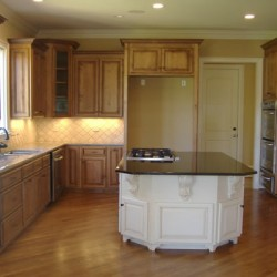 White paint perfectly offsets the island in this Home Services Direct kitchen remodel in Chicago.