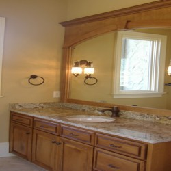 Wood detailing brings character to this Home Services Direct bathroom remodel in Chicago.