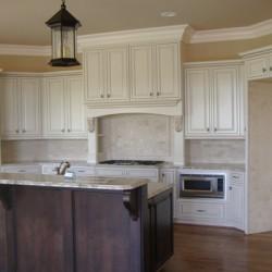 Varying cabinet heights add drama to this Home Services Direct kitchen remodel in Chicago.