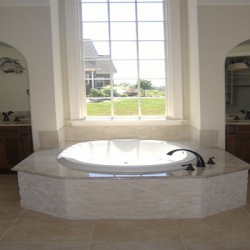 A large window and tub dominate this Home Services Direct bathroom remodeling project in Chicago.