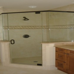 A large, pentagonal shower is the focus of this Chicago bathroom remodeling project by Home Services Direct.