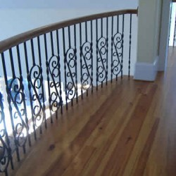 This unique railing design brings character to this Chicago home remodeling project by Home Services Direct.