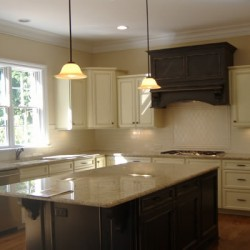 Natural light reveals the cozy feel of this Chicago kitchen remodel by Home Services Direct.