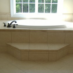 A bath step brings convenience to this Home Services Direct bathroom remodel in Chicago.