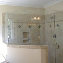 Glass half-walls and other details add character to this Home Services Direct bathroom remodel in Chicago.