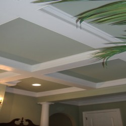 A dramatic, geometric ceiling design brings classic character into the space in this house remodeling project by Home Services Direct in Chicago.