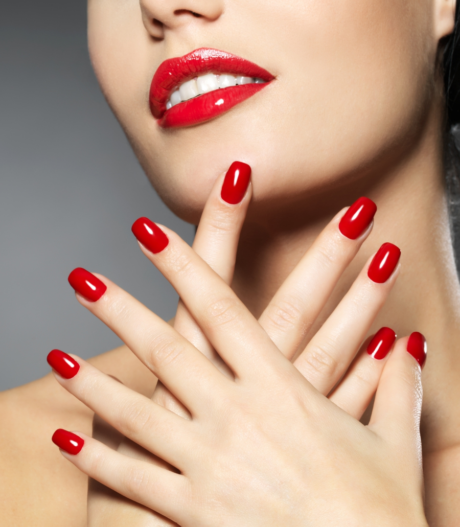 red fingernails from manicure
