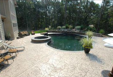 Concrete pool deck with acid stain concrete.
