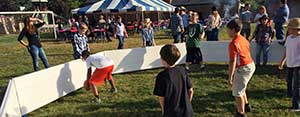Kids enjoying the Octopit USA octoball pit at a gathering.