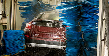 Express car wash on a Honda car.
