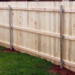 wooden fence installation with metal supports